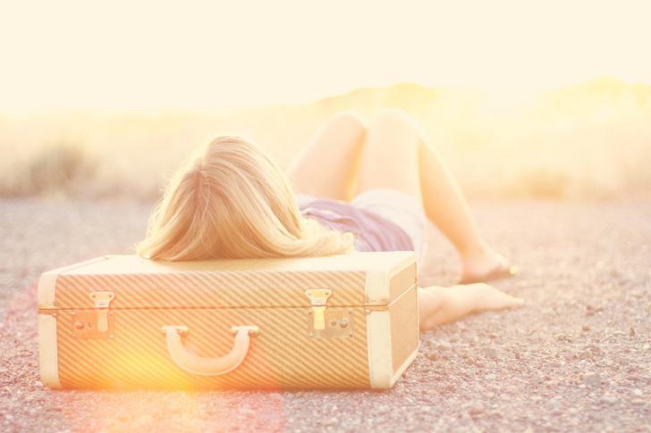 Travel suitcase sun